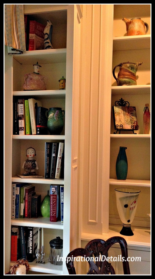 bookcases with art and books