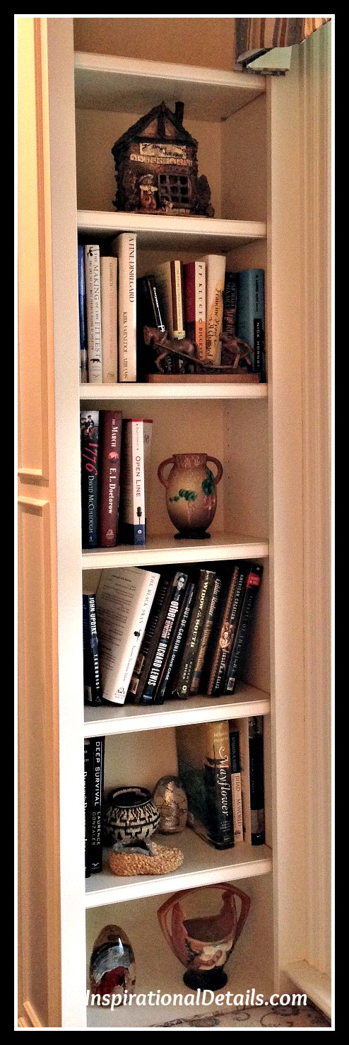 shelves with books and art