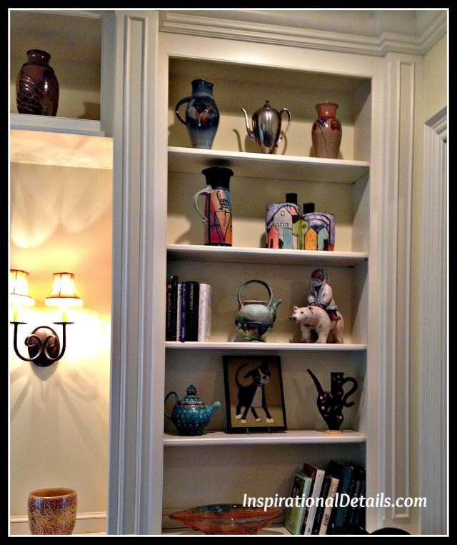 arranging shelves with art pieces